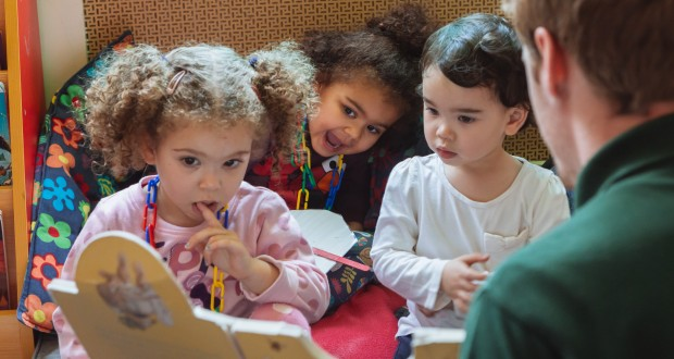 Children can enjoy quiet story time alongside a range of activities. Children love listening to and sharing stories with our staff and their peers.